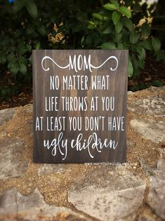 This funny wood sign Mom no matter what life throws at you at least you dont have ugly children measures 10 inches by 11 inches. This sign is one of our best selling items and would make a great gift for your mom for Mothers Day, Christmas, her birthday, or just because..... This sign