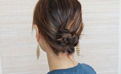 Learn how to tie your hair into a beautiful knotted chignon in six easy steps.