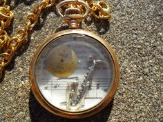 Steampunk Pocket Watch Necklace - Dial and Saxophone 18 in. $40.00, via Etsy.
