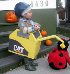 Excavator!! - of course it would need to be John Deere in this family!