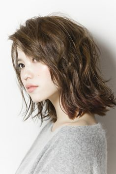 Wavy layered mid length hair, will have to try when I want to go shorter again