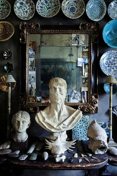 The writer Umberto Pasti's groupings of shells, Islamic ceramics and Roman antiquities in his Milan apartment.  Photo: Simon Watson via T Magazine.