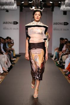 Printed Lycra tube and pencil skirt with frame crop top and cut work embellishment