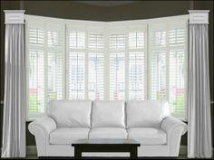 Bay window cornice panels with shutters