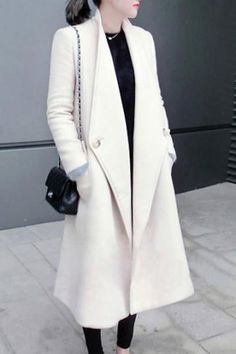 A beautiful white coat. Love the detail.