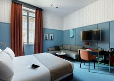 Spanish designer Patricia Urquiola has filled new Milan hotel Room Mate Giulia with a colour clash of custom furniture from Italian brand Cassina