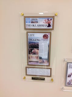 framing a newspaper article with an acrylic style plaque for display gold stand off mounting