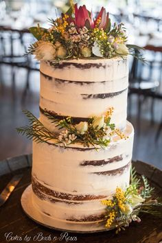 Everlasting daisies and a beautiful desert rose Where does their beauty come from heaven knows................... A Semi naked cake with delightful Australian blooms.