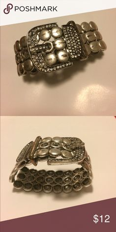 Stretch Bracelet Silver belt buckle style with 5 holes for snug or loose fit. Rhinestones adorn the buckle. Jewelry Bracelets