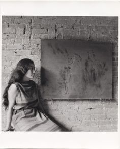"""Yoko Ono with Painting to See in the Dark (Version 1) (1961), as installed at AG Gallery's """"Paintings & Drawings by Yoko Ono,"""" in July 1961. Photography by George Maciunas.©2014 GEORGE MACIUNAS"""
