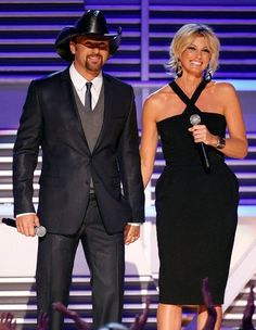 Tim McGraw and Faith Hill on stage at the 2009 George Strait: ACM Artist of the Decade All Star Concert in Las Vegas. Photo credit: Getty Images/Courtesy of the Academy of Country Music & Dick Clark Productions.
