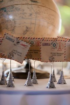 Love traveling? These postcard escort cards are perfect for your wedding! Love the Eiffel Tower card holders! {Genesa Richards Photography}