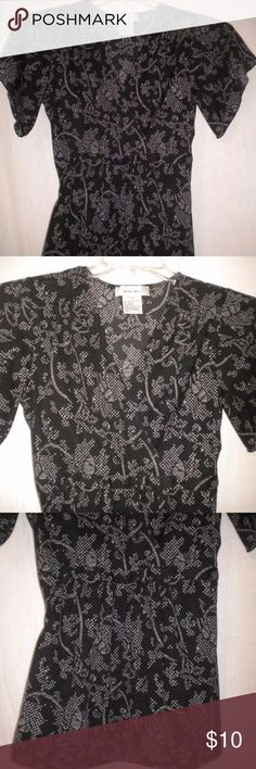 Nine West Women Size Small Top Shirt Blouse Barely Worn. Nine West Women Size Small Shirt. Short Sleeves.  V neck.  Black and white pattern. Ties in the back. Made of 100% Polyester. Chest approximately 36 inches and length approximately 25 inches. Nine West Tops