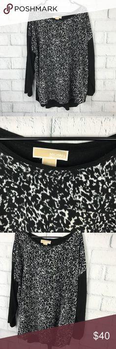 Michael Kors Long Sleeve Knit Top Michael Kors Long Sleeve Knit Top Black and white front pattern, black throughout  Pocket front, Long Sleeve Womens size 3X 70% Viscose / 30% Lyocell Very Good Condition  B8 Michael Kors Tops Blouses