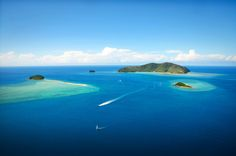 Flying past One&Only Hayman Island, Langford and Bali Hai on the way to the Great Barrier Reef.http://www.thewanderinglens.com/photograph-the-great-barrier-reef/