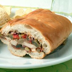 Chicken Muffeletta from Cooking Light. This make-ahead sandwich is a lighter take on an old New Orleans favorite. Use a fork to scrape the bread and hollow the loaves.