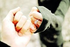 engagement picture: pinky promise w/ ring