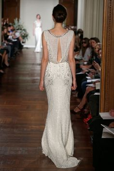 Stunning, i love this type of back, especially on the beaded dresses. the skirt and beading around hips is oh-so-beautiful too. Jenny Packham