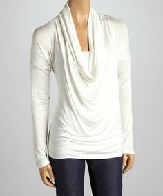 Look chic in this iconic cowl neck top that's bursting with sleek appeal. The lightweight fabric comfortably caresses curves with its lovely stretch-fit, while dainty texture makes it a beautiful everyday wear.Measurements (size S) 29'' long from high point of shoulder to hem95% rayon / 5% spandexHand wash; hang dry