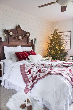 Gorgeous Christmas bedroom decor. Love the reindeer throw!