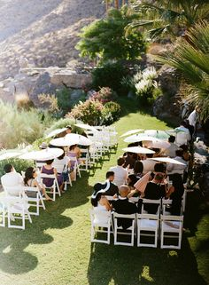 On hot sunny days give your guests a Parasol  o shade them from the sun - it doubles as their 'guest favor'!  http://WeddingWoman.net