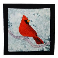 Appliqued and thread painted bird, a cardinal, on hand-dyed fabric by Peggy Wright Sold