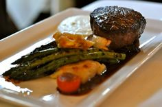 Roquefort stuffed filet of beef tenderloin with grilled asparagus, morel mushrooms and tempura squash blossoms topped with a nouveau Béarnaise sauce. I Restaurant Michael
