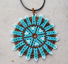 Huichol mandala necklace Mexican Necklace inspired by native Seed Bead Jewelry, Seed Bead Earrings, Beaded Jewelry, Native Beadwork, Native American Beadwork, Bead Embroidery Patterns, Beaded Embroidery, Circle Art, Beaded Animals