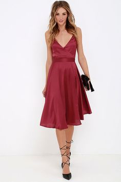 With a modern spin on a classic silhouette, it's no wonder the Stolen My Heart Wine Red Wrap Midi Dress has caught your eye! Lightweight satin forms adjustable spaghetti straps (that cross at back) and a wrap bodice with tying sash. Midi skirt is finished with a subtle convex hem.