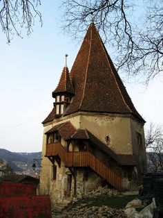 The Shoemakers' Tower, a bastion in the city wall surrounding the centuries-old parts of Sigishoara, Romania. Photo by Susan Pogany. Places Ive Been, Tower, Europe, House Styles, City, Wall, Travel, Beautiful, Viajes