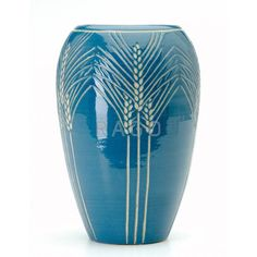 "NORTH DAKOTA SCHOOL OF MINES Tall vase excised by S. Sorlie with sheaves of wheat on a blue-grey ground. Indigo stamp and ELH-750, S Sorlie. 8 1/2"" x 6"" - Price Estimate: $2000 - $0"