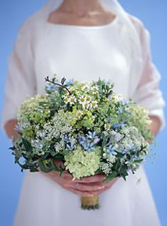 wildflowers: hydrangea, chamomile, queen anne's lace, lady's mantle, tweedia, with mint