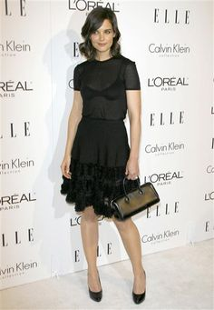 Hot mama! Katie Holmes dared to bare her underwear in a sheer blouse and frilly Azzedine Alaia skirt at the 2009 Elle Women in Hollywood Tribute in Beverly Hills, Calif.