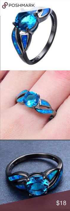 Unique Black Gold Filled/Blue Fashion Ring This ring is so pretty and NWOT. I love the blue stones. The side stones glow like Opal. Really as lovely as the pic. Jewelry Rings