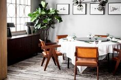 Gray dining room with leather chairs.