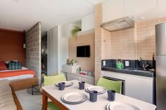 Studio Vila Olimpia: A Compact Apartment with Flexible Living Spaces that Meet Tenant Needs Apartment Interior, Simple Furniture, Home, Living Place, Living Spaces, Round Table And Chairs, Home Furniture, Tiny House Furniture, Colorful Interior Design