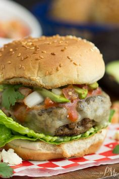 This Enchilada Burger Recipe is packed with flavorful Tex-Mex seasoning. #burgermonth