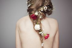 Love the flowers in the hair, minus the roses. That's a little much for me.