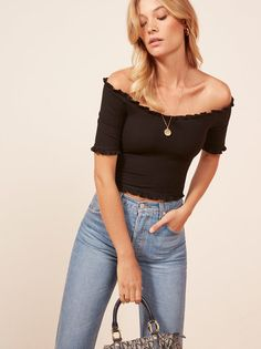 Cute top. This is an off-the-shoulder crop top with a ruffle edged neckline and hem.