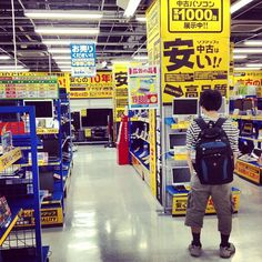Checking out the bargains in Sofmap s head store, Akihabara, Tokyo