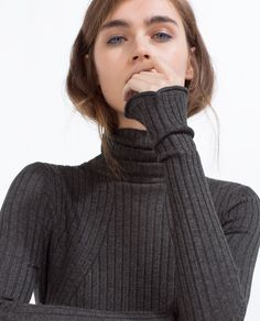 SWEATER WITH A ROLL-NECK - Available in more colours