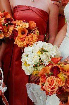I like the rust/orange colors! brides maid dresses, perfect for a fall wedding.