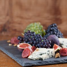 ancientcookware.com  one gorgeous cheese board - also small slate plates can be used to serve dessert like flan