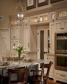 love this french kitchen, beautiful kitchen cabinets, especially love the lighted upper glass cabinets.