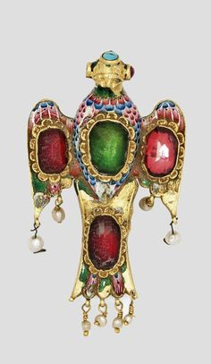 Iran | Qajar enamelled gold pendant; form of a spread bird inset with foiled hardstones, the polychrome enamel decoration rendering feathers to the front, the reverse with floral sprays, the wings and tail with hanging pearls | 19th century | 3'750£ ~ sold (Apr '14)