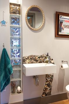 make your own backsplash with beach pebbles and glass. Tiled/mosaic....