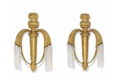 SIMONET FRÈRES A PAIR OF TWIN-BRANCH APPLIQUES, CIRCA 1925 gilt-bronze, the branches issuing pendant glass beads 18.3/4 in. (47.6 cm.) high