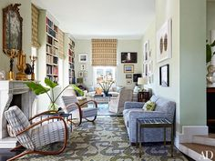 The heart of the apartment is a long, high-ceilinged room divided into living and dining areas, each anchored by Allegra Hicks carpets. The designer also created the Roman-shade fabric, the cut velvet on the wood-framed Jindrich Halabala armchairs, and the butterfly-specimen table at right; an 18th-century Venetian mirror surmounts the mantel.
