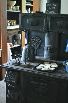 I love this old stove and the shelves of preserves and canned items in the next room! The Homestead Diaries | Ginger and Molasses