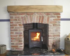This customer already has their stove & a small granite hearth already installed, but wanted to give the installation a more rustic feel. Our skilled HETAS fitters created this bespoke brick fireplace with solid oak beam. We were also able to find a perfect match to extend the existing granite hearth.